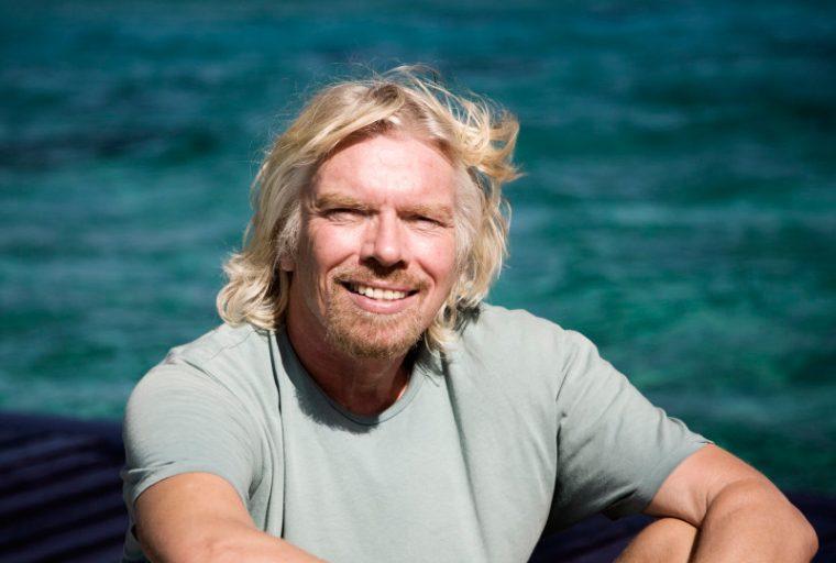 Richard Branson smiling on an island